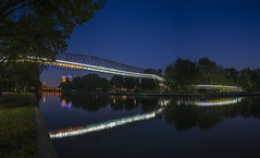 Slinky springs to fame - Panorama (stefanfricke) Tags: slinkyspringstofame panorama bridge rheinhernekanal oberhausen tobiasrehberger color water reflection illumination night light sony ilce7rm2 sel1635z