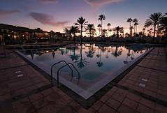 pool sunset (KalleKarl) Tags: olympusbcl9mm panasonicgx85 panasonicgx80 panasoniclumix mft darktable pool grancanaria canarias maspalomas hdparquecristobal