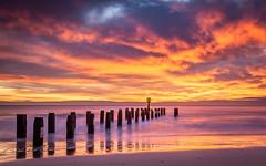 Sunrise over Lowestoft Beach (dpowley65) Tags: clouds seadefences seascape orange beach sunrise lowestoft