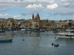 103_Marsaxlokk (SmoKingTiger1551) Tags: malta isle mediterranean marsaxlokk port sea water boats temple church clouds