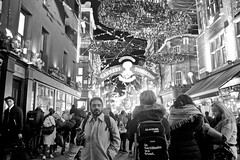Carnaby Street (I M Roberts) Tags: carnabystreet centrallondon christmaslights crowds tourists w1 fujix100s bw