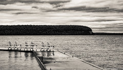 No trip to Door County would be complete without a picture of empty Adirondack chairs (Jim Frazier) Tags: 2019 201910doorcountyoctober2019 3d3layer bw adirondackchairs atmospheric autumn bay blackandwhite chairs cloudy deepdepthoffield desaturated diagonals door doorcounty emptychairs emptyseats ephraim fall furniture harbor isolationofsubject jimfraziercom lake landscape leadinglines lines loadcode201912 marine maritime minimalism monochrome nature nautical october oldified overcast pier q4 roadtrip ruleofspace scenery scenic sea seascape seats sepia simplicity sizeover1000 sound structures subjectseparation tofinishediting triangles vacation water waterscape wi wisconsin f10