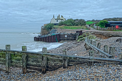 Living on the Edge (Croydon Clicker) Tags: beach groyne footpath cottage cliff shingle lifebelt sea ocean water channel sky cloud cuckmerehaven eastsussex sussex nikon nikkor