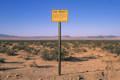 state property. mojave desert, ca. 2014. (eyetwist) Tags: eyetwistkevinballuff eyetwist sign stateproperty johnsonvalley landscape empty mojavedesert california nikon n90s nikkor 28105mmf3545d fuji velvia 50 rvp transparency chrome slide nikonn90s fujivelvia50rvp ishootfilm ishootfuji analog analogue film emulsion coolscan 35mm 28105mm iconla southwest usa dirt horizon mojave desert decay roadsideamerica type typography typographic typology minimalist yellow prosecuted molesting fullextentofthelaw flat lucernevalley