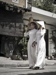 Hoi An 14 (arsamie) Tags: hoian vietnam asia girls women ao dai aodai non la nonla hat chinese conical triangle street white bokeh smile style fashion classy handinhand walk folklore legacy tradition