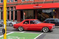 Red Car, Cumberland St. at Stuart St., Dunedin, New Zealand, 10.55 AM Thurs. 5 Dec. 2019 (mark_mcguire) Tags: dunedin dunedinnz newzealand nz dunnerstunner streetphotography urbanphotography canpubphoto sonya7iii sony55mm