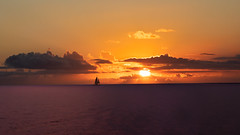 Waikiki Sunset Sail (cheezepleaze) Tags: hawaii sunset waikikibeach sailing orange tropics clouds sea hss honolulu