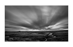 Strong winds (Photodoos) Tags: bw sunrise wind clouds streaks canonnl zierikzee zeeland