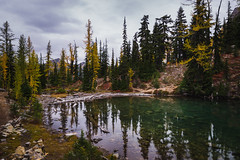 Lake in North Cascades (Ash and Debris) Tags: view autumn usa washington pine mirror nature nationalpark mountains lake fall stones clouds trees woods sky forest wood reflection colors park unitedstates yellow northcascades water