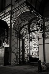 Reflection of past years (vazek2007) Tags: sigma foveon sdquattro antique architecture gate reflections pattern night monochrome blackandwhite blackandwhitephotography bnwphoto bnw