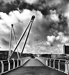 Millennium Bridge, Newport (Hammerhead27) Tags: iphone monochrome suspended walkway architecture morning sunday sunny blackandwhite southwales newport river bridge
