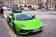 Paris, France - January 13th 2019 : Green Lamborghini aventador parked on the Champs-Elysees, with people. (Lucille Cottin) Tags: auto city car drive design construction automobile europe european capital engine automotive exhibition concept expansive france green modern french outside exterior outdoor fast motor expensive lamborghini luxury luxe lamborghiniaventador show road street paris sport race speed town technology power style structure rare supercar parisian urban wall îledefrance transport transportation vehicle
