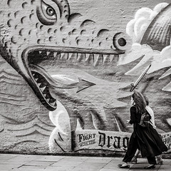 watch out! (Gerard Koopen) Tags: uk unitedkingdom london street streetart wallpainting streetphotography watchout people woman women walking dragon fire blackandwhite monochrome noir blackandwhiteonly fujifilm fuji xpro2 fujilove fujilover 2019 gerardkoopen gerardkoopenphotography