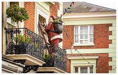 Breaking and Entering (Mandy Willard) Tags: santa fatherchristmas balcony house break tree