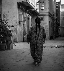 A Long Tradition (Kashgar, China. Gustavo Thomas © 2019) (Gustavo Thomas) Tags: long hair woman people kashgar oldcity unesco world xinjiang uyghur uighur muslim life tradition travel voyager china mono blackandwhite bnw