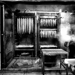 smoked trout (Le Xuan-Cung) Tags: smokedtrout christmasmarket dortmund nrw germany streetphotgraphy sw bw nb noiretblanc blackandwhite