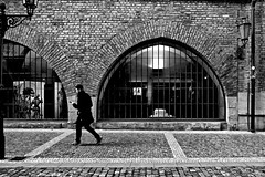 _ _ _  in a hurry  _ _ _ (christikren) Tags: blackwhite bw black christikren city dark europe human candid man hurry street streetphotography praha sw oldtown window art one lonely light panasonic