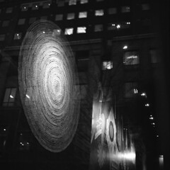 untitled (kaumpphoto) Tags: rolleiflex 120 tlr ilford hp5 bw black white city urban street windows minneapolis abstract oval curve woven weave textile reflection night