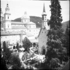 salzburg (inmelancholysilence) Tags: film analog analogue lofi lomo lomography dianamini squareformat salzburg austria graveyard church cemetery