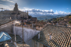 Urbino roofs (alfsan) Tags: blue clouds tiles roof tower palace crane pentaxart