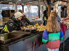 """At the Christmas Market"" (Terje Helberg Photography) Tags: candid christmasmarket citylife citywalk customer food interaction market outdoor people salesman salesperson seafood street streetmarket streetphotography streetlife urban"