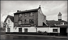 The Crossroads, Weedon (Jason 87030) Tags: pub inn hotel a5 highst street roadside weedon bec village northants northamptonshire bw bbw bnw tones meal food beer black noir white blanc building roof windows sign architecture uk english england tavern clock tower face time lunch