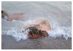 waves over rocks (mcfcrandall) Tags: kewbeach water lakeontario lake rocks dof waves splash pebbles granite