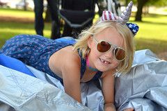 The unicorn with the missing tooth (radargeek) Tags: libertyfest 2019 4thofjuly july parade edmond oklahoma ok summer kid child unicorn sunglasses girl smile