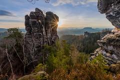 December Morning (Uwe Kögler) Tags: saxony sachsen sächsischeschweiz sunrise sonnenaufgang elbsandsteingebirge rocks rock rathen felsen sandstein germany deutschland gansfelsen gans sonne sonnenstern dezember lilienstein mönch