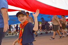A wave from under the flag (radargeek) Tags: libertyfest 2019 4thofjuly july parade edmond oklahoma ok summer kid child flag bsa cubscouts giant boy