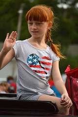 Waving in the parade (radargeek) Tags: libertyfest 2019 4thofjuly july parade edmond oklahoma ok summer kid child girl redhair