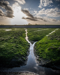 Behind the dykes (G. Warrink) Tags: waddenzee waddensea unesco unescoworldheritage unescoworldheritagesite moddergat friesland frisia nature outsideisfree sun sea clouds water coast mud