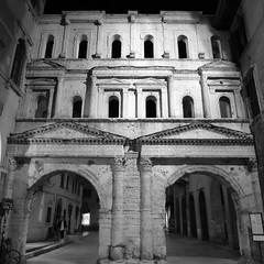 An evening view of Verona's Porta Borsari, an ancient Roman city gate (Scott Mundy) Tags: night view verona porta borsari photo evening bw black white monochrome ancient roman city gate geotagged