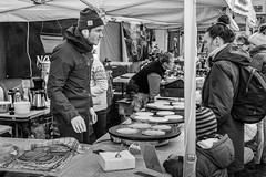 """At the Christmas Market"" (Terje Helberg Photography) Tags: blackandwhite bnw bw candid christmasmarket citylife citywalk customer interaction market mono monochrome outdoor people salesman salesperson street streetmarket streetphotography streetlife urban"
