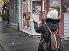 """Food documentary"" (Terje Helberg Photography) Tags: candid citylife citywalk hotdog outdoor people street streetphotography streetlife tourist urban meal eating"