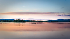 A rowing boat on a northern summer night (ikkasj) Tags: summer lights lake nature nordic rowing