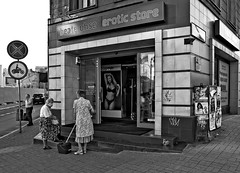Erotic Store (JMZ Photos) Tags: olympus e3 1260mm zuiko poznan poland street erotic store shop old women bw black white outside streetphoto