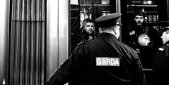 Passing Streetcar (Owen J Fitzpatrick) Tags: ojf people photography nikon fitzpatrick d3100 ireland editorial ojfitzpatrick dublin city candid joe candidphotography candidphoto unposed j photoshoot street streetphoto streetphotography black white mono blackwhite blackandwhite monochrome blancoynegro pretoebranco bw face dublinshoot irish portrait streetshoot photo photograph capture candids photos captures portraits photographs profile garda police security policeman gardai light rail tram streetcar reflect reflections window carriage glass pro cathedral gay byrne funeral marlborough personnel luas urban guards radio walkietalkie train owen use chasing pavement