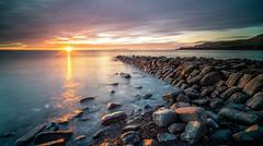 Kimmeridge Sunset (grahamhutton) Tags: sonya7 sonyemount samyng18mmf28fe leeseven5filters leereversegrad kimmeridge kimmeridgeledges jurassiccoast dorset dorsetcoast sunset starburst longexposure wareham clavelltower kimmeridgepier