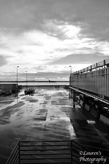 Rain delay almost over (HSS!) (lauren3838 photography) Tags: laurensphotography lauren3838photography landscape airport airplane clouds sky monochrome bw denver dia tarmac runway colorado co nikon d750 rain weather dof hss happyslidersunday
