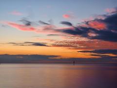 Sky Drama (rosgloryfire) Tags: cloudstack storm australia seascape color bay evening scenic reflections dusk water olympus light clouds skydrama bluehour sunset sun sea sky nature landscape nisifilters longexposure