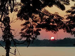 Sunset reflections along the Mekong RIver in Phon Phisai 3 (SierraSunrise) Tags: sunset thailand isaan esarn nongkhai phonphisai reflection rivers mekong silhouette air pollution smoky mekongriver