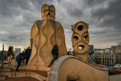 The Terrace Sculptures (henriksundholm.com) Tags: architecture antonigaudi casamila lapedrera terrace roof sculpture people clouds cloudy sky overcast city urban rooftop steps sign hdr barcelona spain espana catalonia