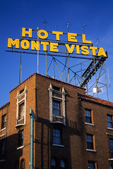 monte vista / route 66. flagstaff, az. 1999. (eyetwist) Tags: eyetwistkevinballuff eyetwist route66 flagstaff arizona montevista hotel neon yellow brick landmark sign nikon n90s sigma 2470 f28 fuji velvia 50 rvp nikonn90s sigma2470f28exdg fujivelvia50rvp scansfromthearchives film emulsion analog analogue ishootfilm ishootfuji fujichrome circularpolarizer signage motel unique vintage retro type typography vacancy roadsideamerica american americana desert southwest roadtrip route 66 usa 35mm 1999 overnight room