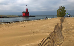 Holland Lighthouse (1) (tquist24) Tags: bigredlighthouse holland hollandharborlighthouse hollandstatepark lakemichigan michigan outdoor beach cellphone clouds geotagged iphone iphonex lighthouse outside sand seascape sky tree water