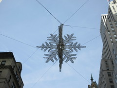 IMG_1590 (Brechtbug) Tags: 2019 snow flake star light christmas decor 5th avenue 57th street intersection with empire state building distance new york city december decoration holiday profile figure art architecture day evening afternoon buildings manhattan uptown midtown near central park 12082019 nyc snowflake night nite superman movie baby space ship