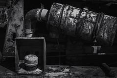 Old Parts (hutchphotography2020) Tags: motor rusty junk cap muffler farmequipment hose mono blackandwhite nikon