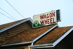 Fred's Wagon Wheel - Delevan, Wisconsin (Cragin Spring) Tags: wisconsin wi midwest unitedstates usa unitedstatesofamerica southernwisconsin delevan delevanwi delevanwisconsin fredswagonwheel freds wagonwheel bar sign rural tavern