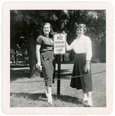 No Parking—Loading Zone (Alan Mays) Tags: ephemera photographs photos foundphotos snapshots portraits women clothes clothing dresses skirts signs trafficsigns roadsigns noparkingsigns loadingzonesigns noparking loadingzones humor humorous funny amusing antique old vintage vptp smiling smiles