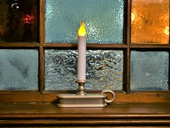 This Little Light... (slammerking) Tags: candle stainedglass window woodwork